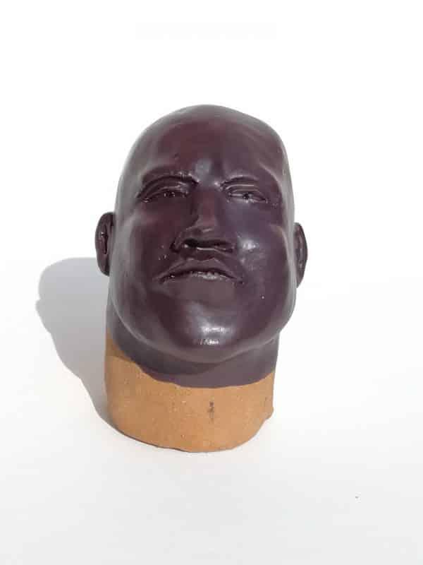 Tête d'homme noir en grès émaillé